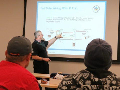Roger Schmidt from ASSA ABLOY instructs technicians on fail safe lock wiring.